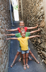 Funny children on narrow street