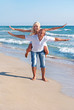 loving couple flying positive on sea beach