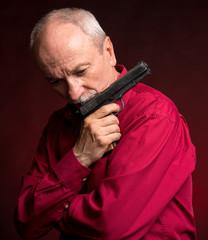 Senior man with a gun