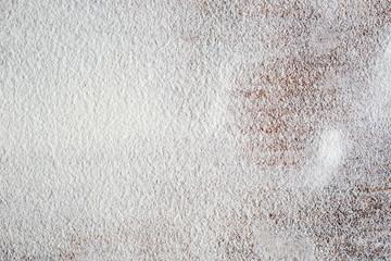 white flour on wooden table