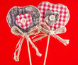 two valentine hearts with bow against red background