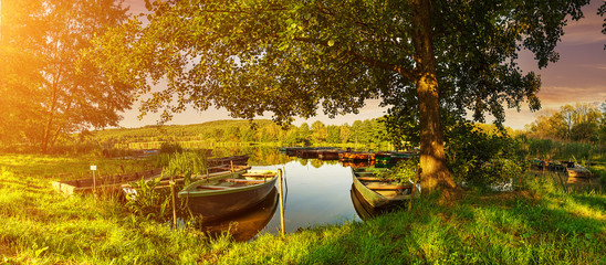 Under the trees, boats in the harbor at Lake © Zsolnai Gergely