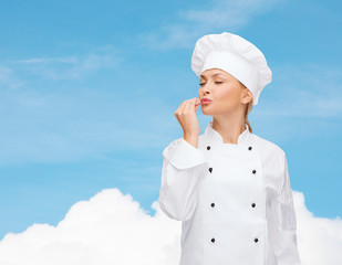smiling female chef showing delicious sign