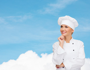 smiling female chef dreaming
