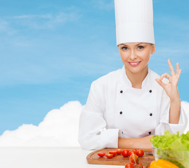 female chef with vegetables showing ok sign