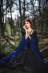 Portrait of beautiful medieval lady in fairy forest