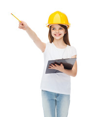 little girl in protective helmet with clipboard