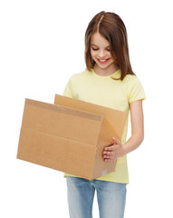 smiling little girl with many cardboard boxes