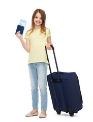 smiling girl with suitcase, ticket and passport