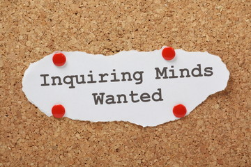 The phrase Inquiring Minds Wanted on a notice board