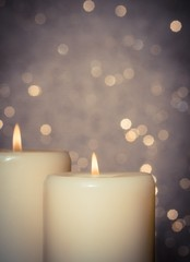candles with flame on bokeh