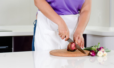 Woman chopping fresh vegetables