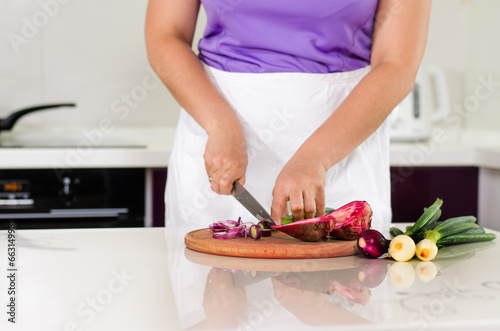 Housewife chopping vegetables in the kitchen