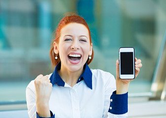Happy woman showing her smart phone