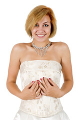 Happy girl in a white evening dress and necklace. Bare shoulders
