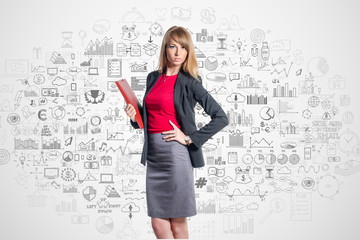 Portrait of young businesswoman with red folder gray skirt shirt