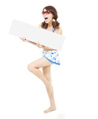 smiling pretty woman standing and holding a board