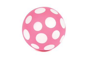 Pink spotted ball isolated on white. Clipping path included.