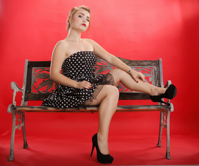 Young woman on a retro bench