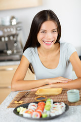 Healthy lifestyle - asian woman sitting with sushi