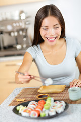 Asian young woman taking healthy lifestyle sushi