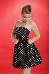 Pinup looking polka dot on bright red