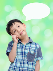 Young Asian boy thinking isolated on abstract bokeh background w