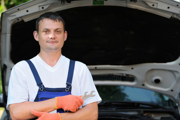 Car mechanic in auto repair service