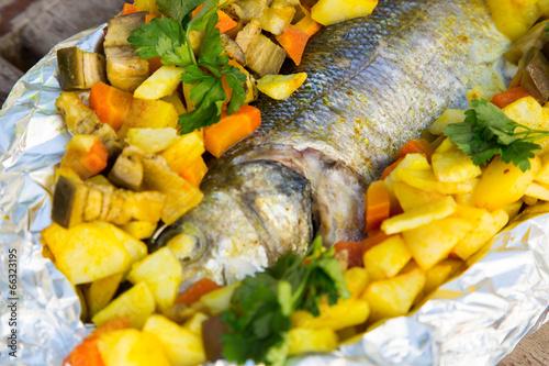 Baked sea bass with vegetables and curcuma
