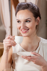 Beautiful woman drinking espresso