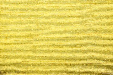 corrugated texture of golden color with stamping