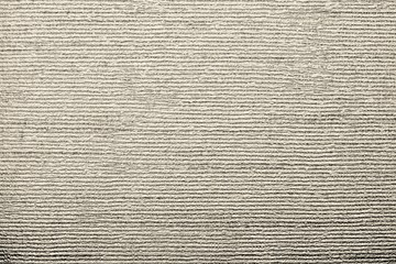 corrugated texture of beige color with stamping