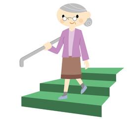 手摺を掴むおばあちゃん