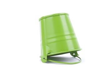 Green metal bucket isolated on a white background.