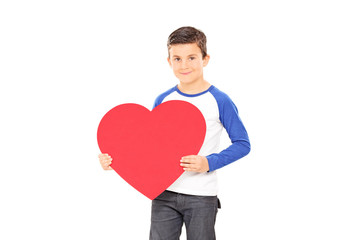Boy holding a big red heart