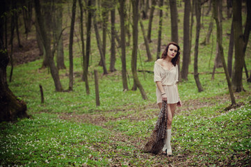 Fashionable woman on a hardwood forest