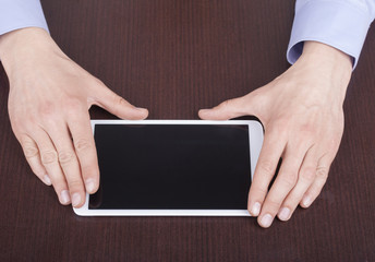 Businessman hands are touching on contemporary tablet pc.