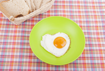 Scrambled in a heart shape on a plate.