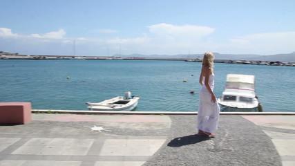 woman walking along the waterfront