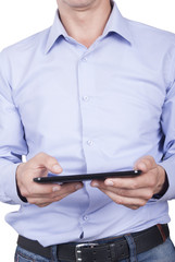 Man with tablet in hands close-up.