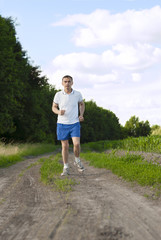 Sportsman running on the open countryside.
