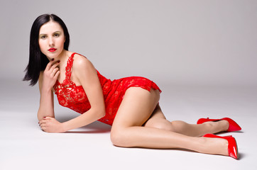 Sexy young woman in a red lace nightie