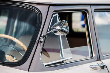 close-up view of a classic vintage car. mirror
