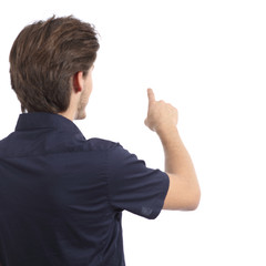 Back view of a man pushing button in the air