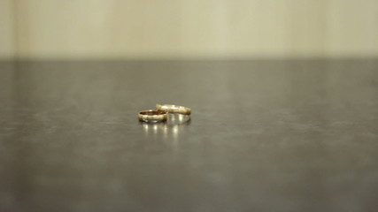 two beautiful wedding rings lie on a dark background