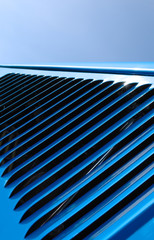 blue vehicle engine grille abstract