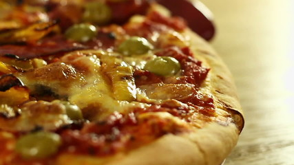 Close-up of a spinning pizza, slow motion