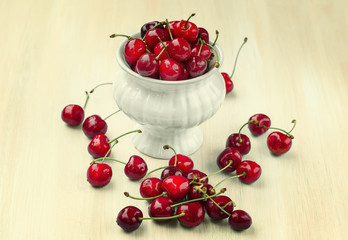 Ripe cherries on a wooden background  with retro filter effect