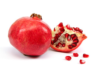 Fresh pomegranate on white background.