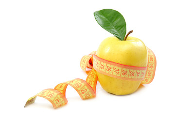 Fresh apple and measuring tape.